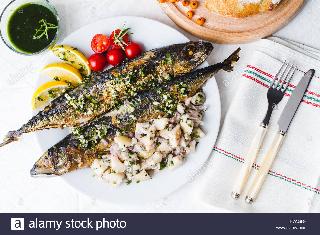 Plate of fresh roasted whole mackerel fish christmas eve for Christmas eve fish dinner