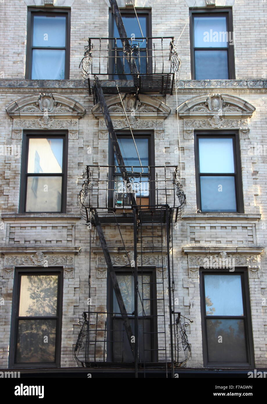 Apartment Building Fire Escape Ladder fire escape steel ladder on white apartment building facade in new