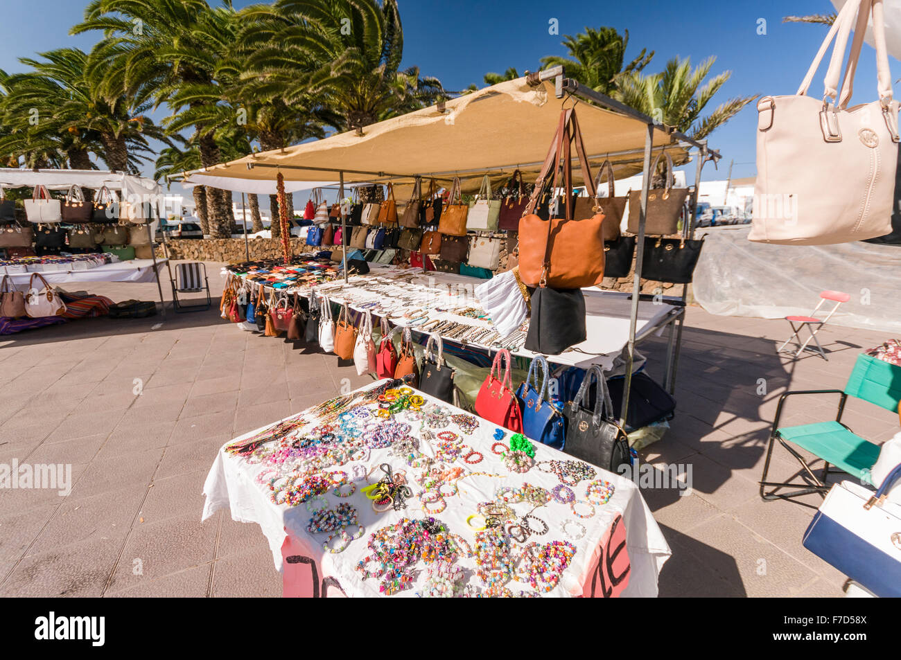 Handbags jewelry and leather goods for sale including fakes at a handbags jewelry and leather goods for sale including fakes at a stall in the sunday market in the lanzarote town of teguise voltagebd Choice Image
