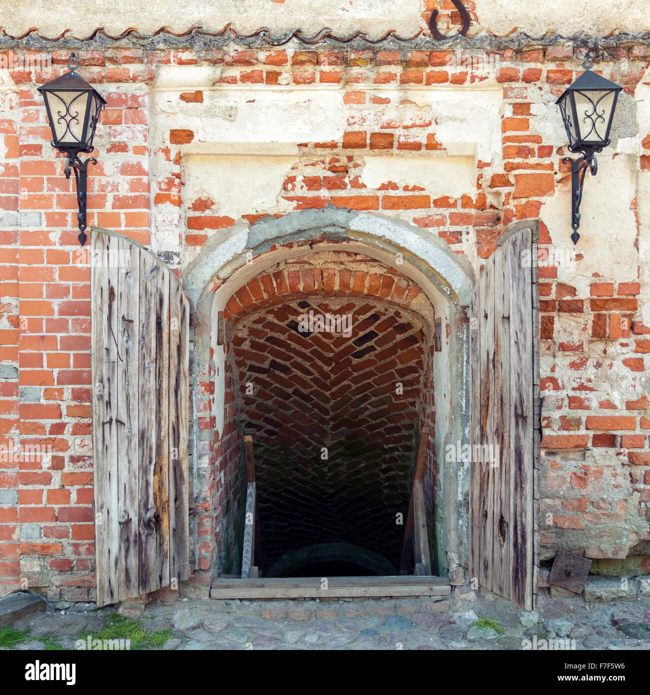 Opened weathered wooden doors leading to the dungeon of an old castle & Opened weathered wooden doors leading to the dungeon of an old ... Pezcame.Com
