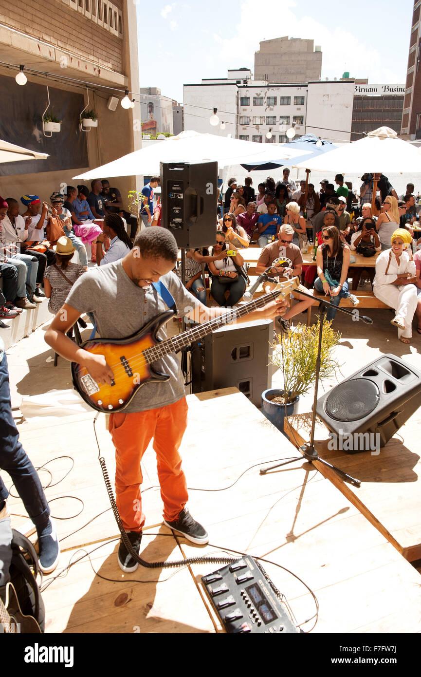 A Musical Tunes A Bass Guitar On A Roof Top Bar In The Neighbourgoods  Market In The Braamfontein Neighbourhood Of Downtown Joha