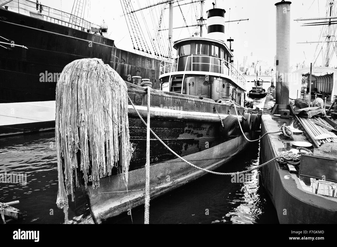 Old fishing boat in new york docks black and white shot for Fishing boats nyc