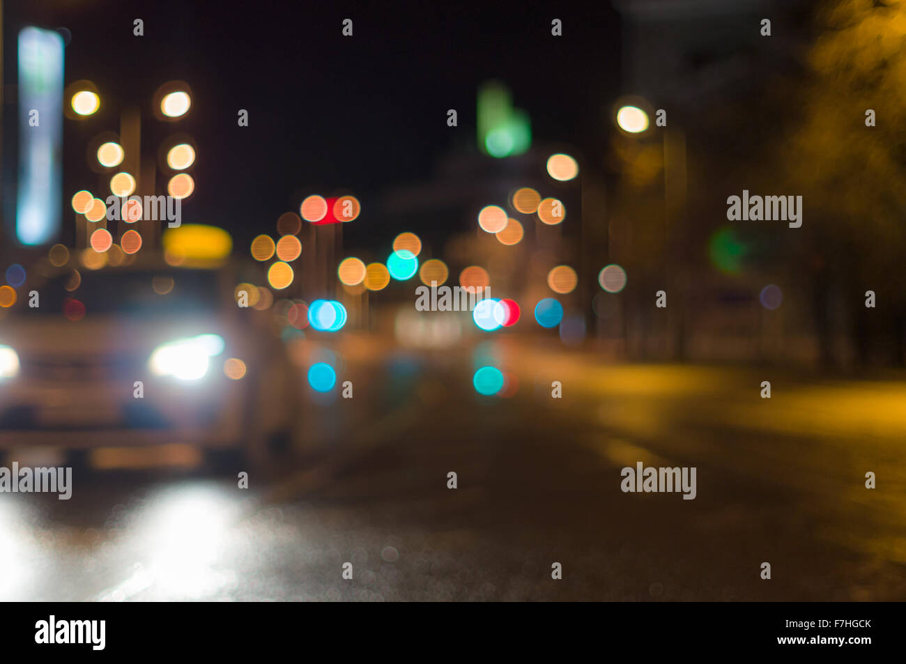Blurry night city lights from a car while driving Stock Photo ...