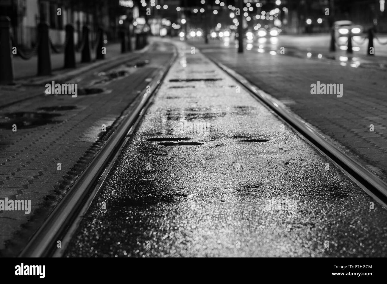 Background image rails - Night View On Wet Tram Rails After Rain Blurred Traffic Lights On Background Black And White Tone