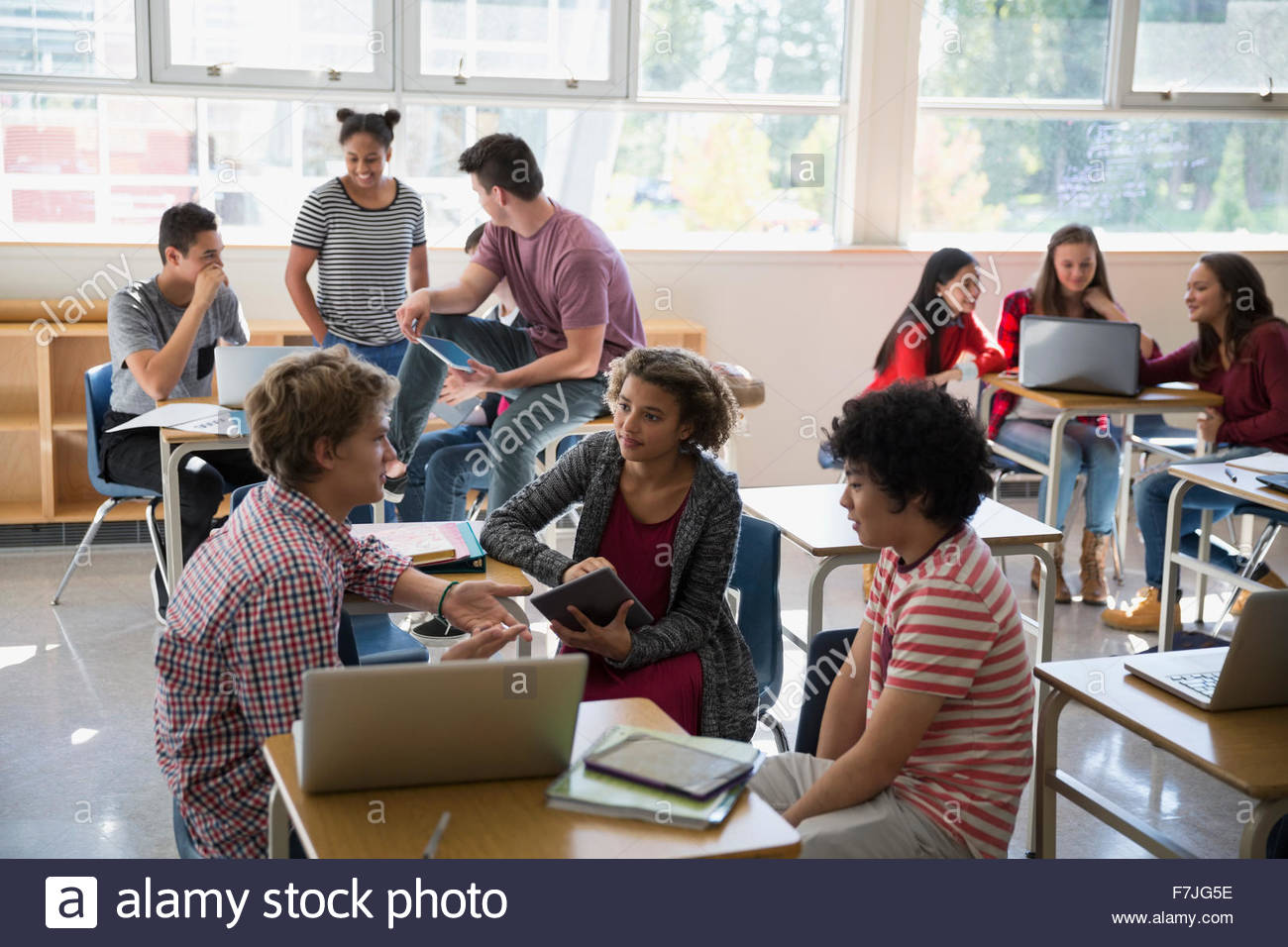 High school students studying in groups in classroom Stock ...