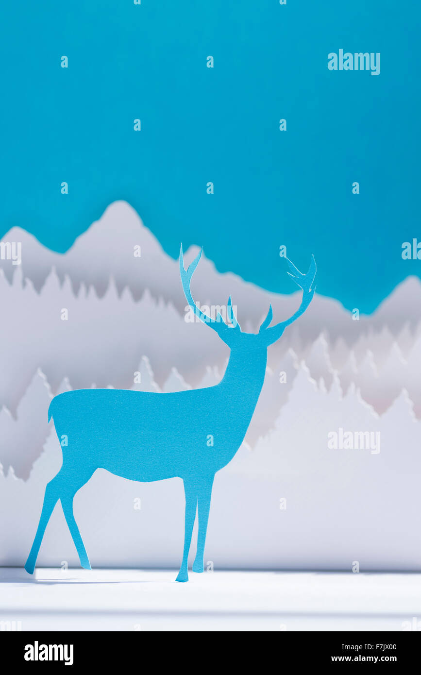 holiday paper cut blue reindeer in winter forest background holiday paper cut blue reindeer in winter forest background handmade template ideal for christmas greeting card new year