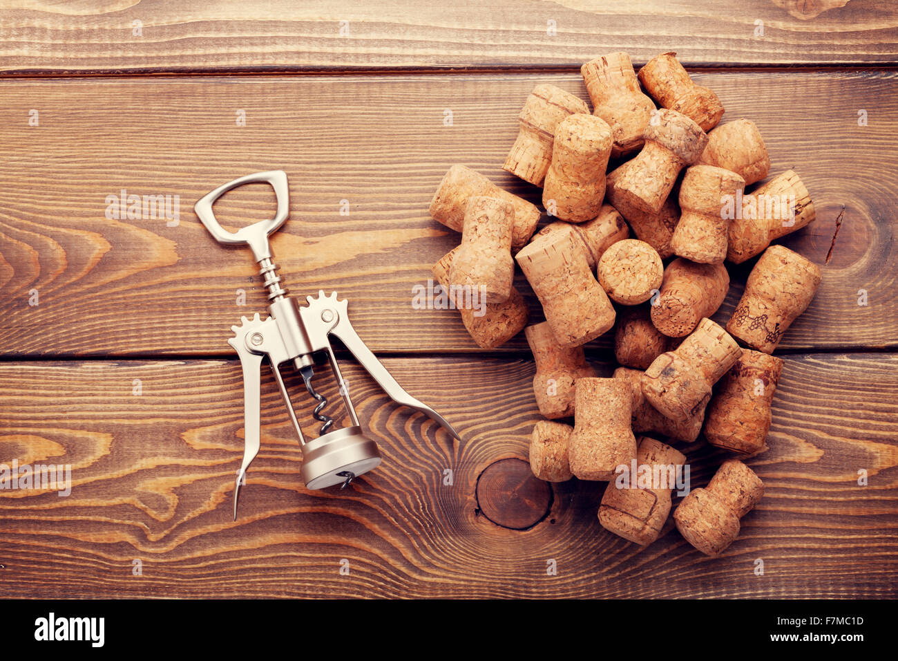 Stock Photo   Wine Corks And Corkscrew Over Rustic Wooden Table Background.  Top View