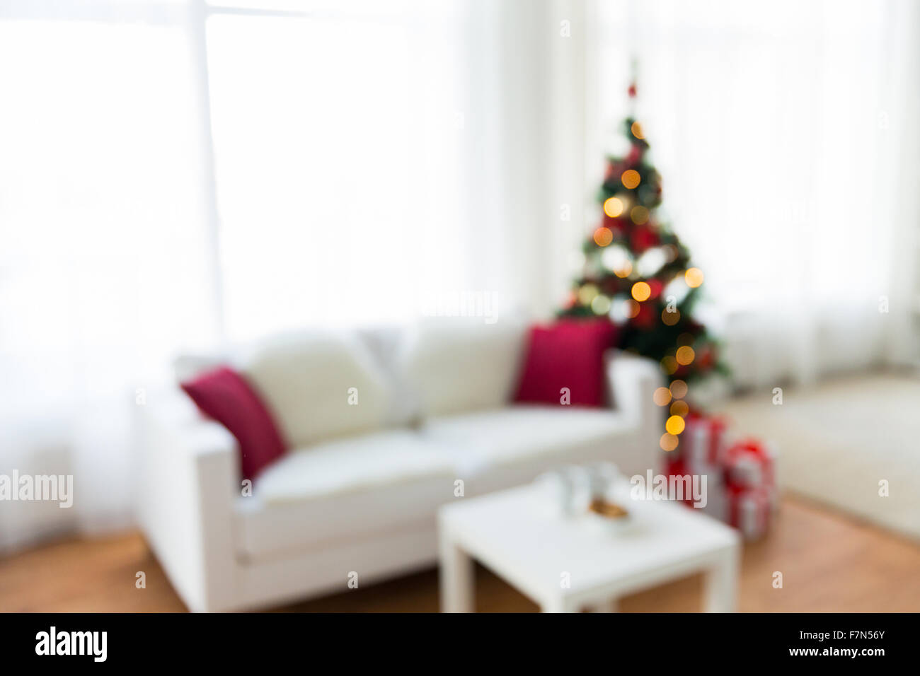 Blurred Living Room With Christmas Tree Background Stock Photo