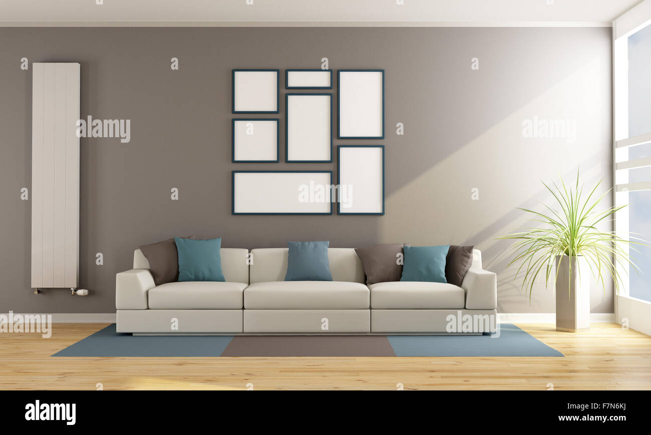 Contemporary living room with sofa vertical radiator and blank frame stock photo royalty free for Contemporary radiators for living room