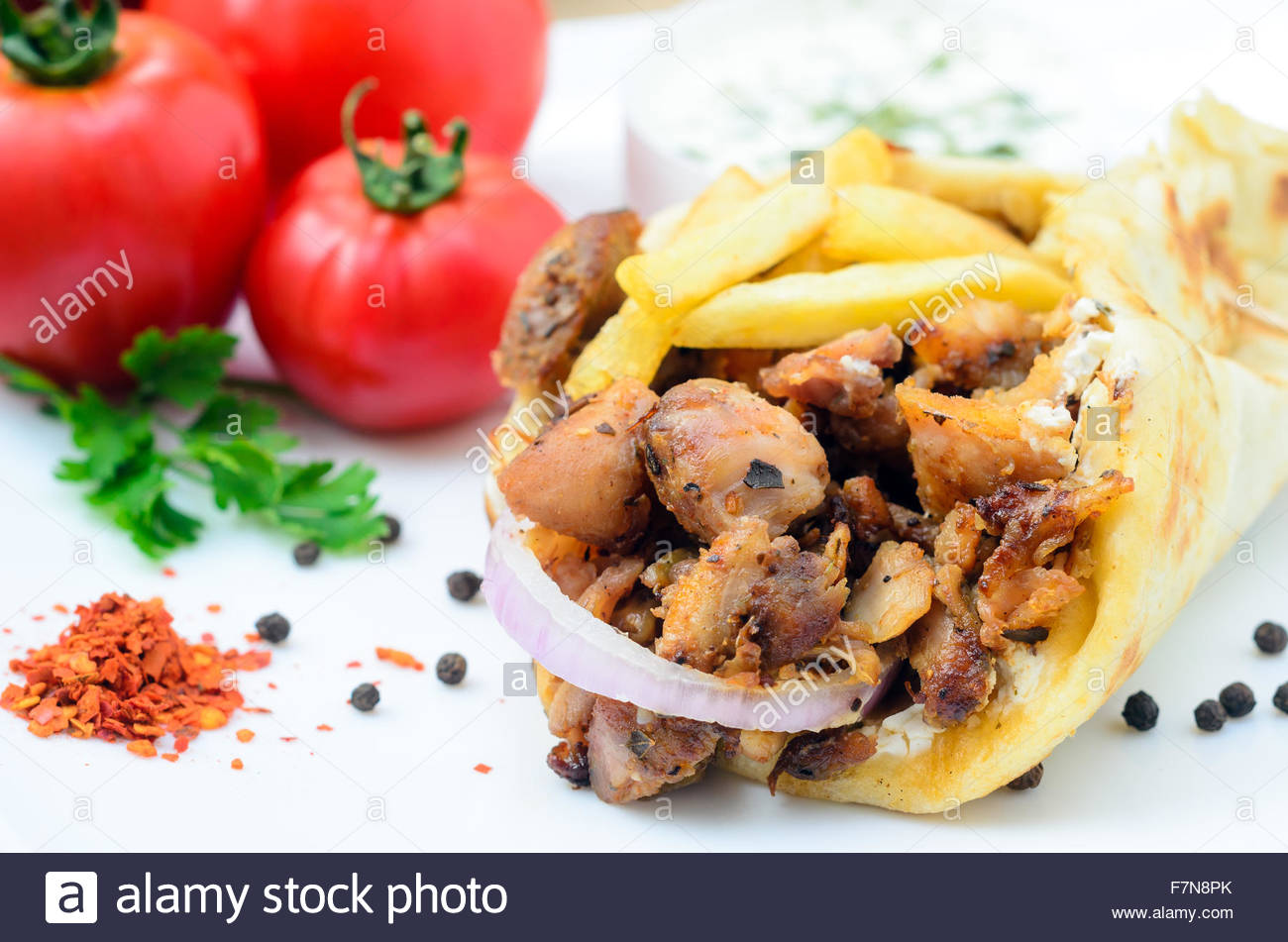 Plate Of Traditional Greek Gyros With Meat Fried Potatoes Tomato And Onion