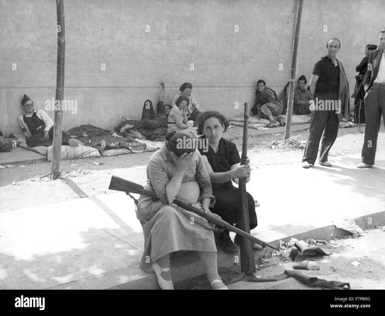 Stock photo republicans women with rifles rest during a lull in the spanish civil war