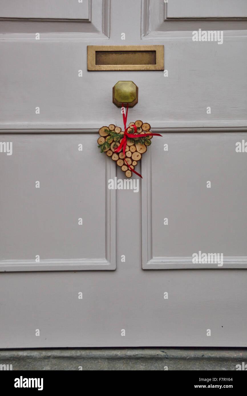 Heart shaped christmas wreath on white front door stock photo heart shaped christmas wreath on white front door rubansaba
