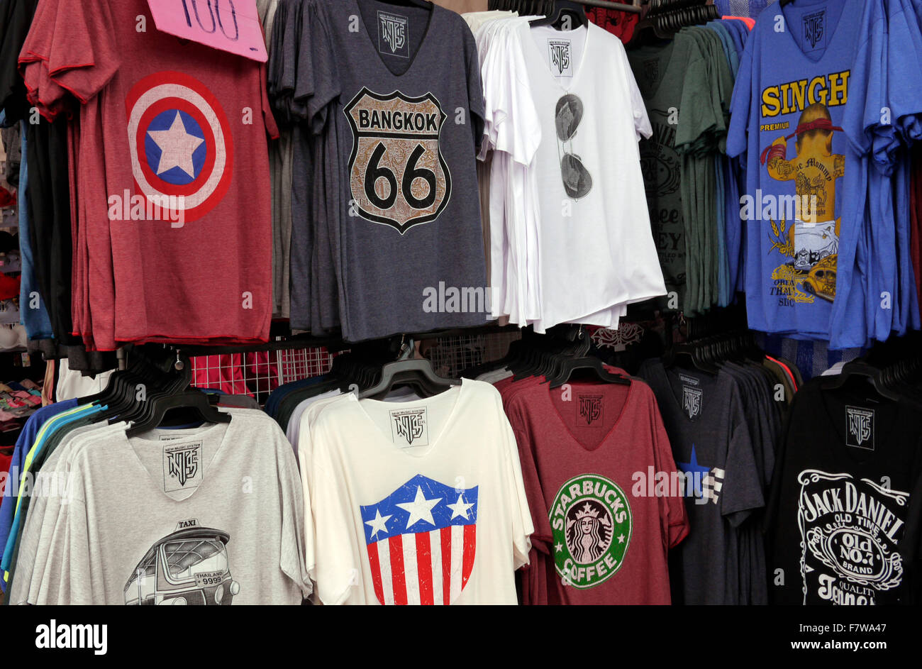 T Shirts for sale on a market stall in Thailand Stock Photo ...