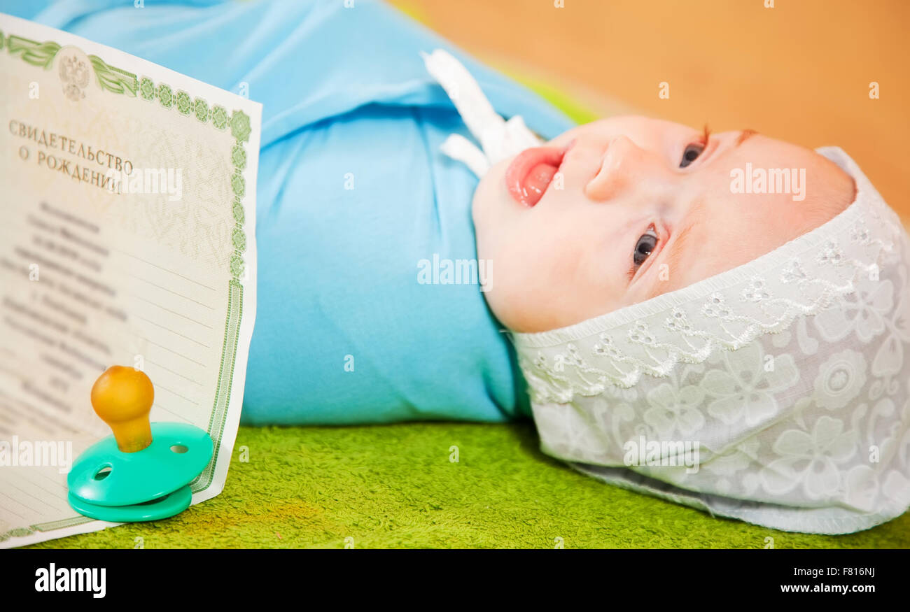 Newborn baby with certificate of birth stock photo royalty free newborn baby with certificate of birth aiddatafo Images