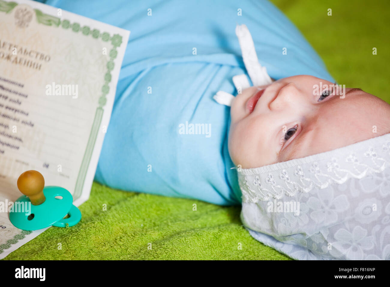 New born baby with certificate of birth stock photo royalty free new born baby with certificate of birth aiddatafo Images