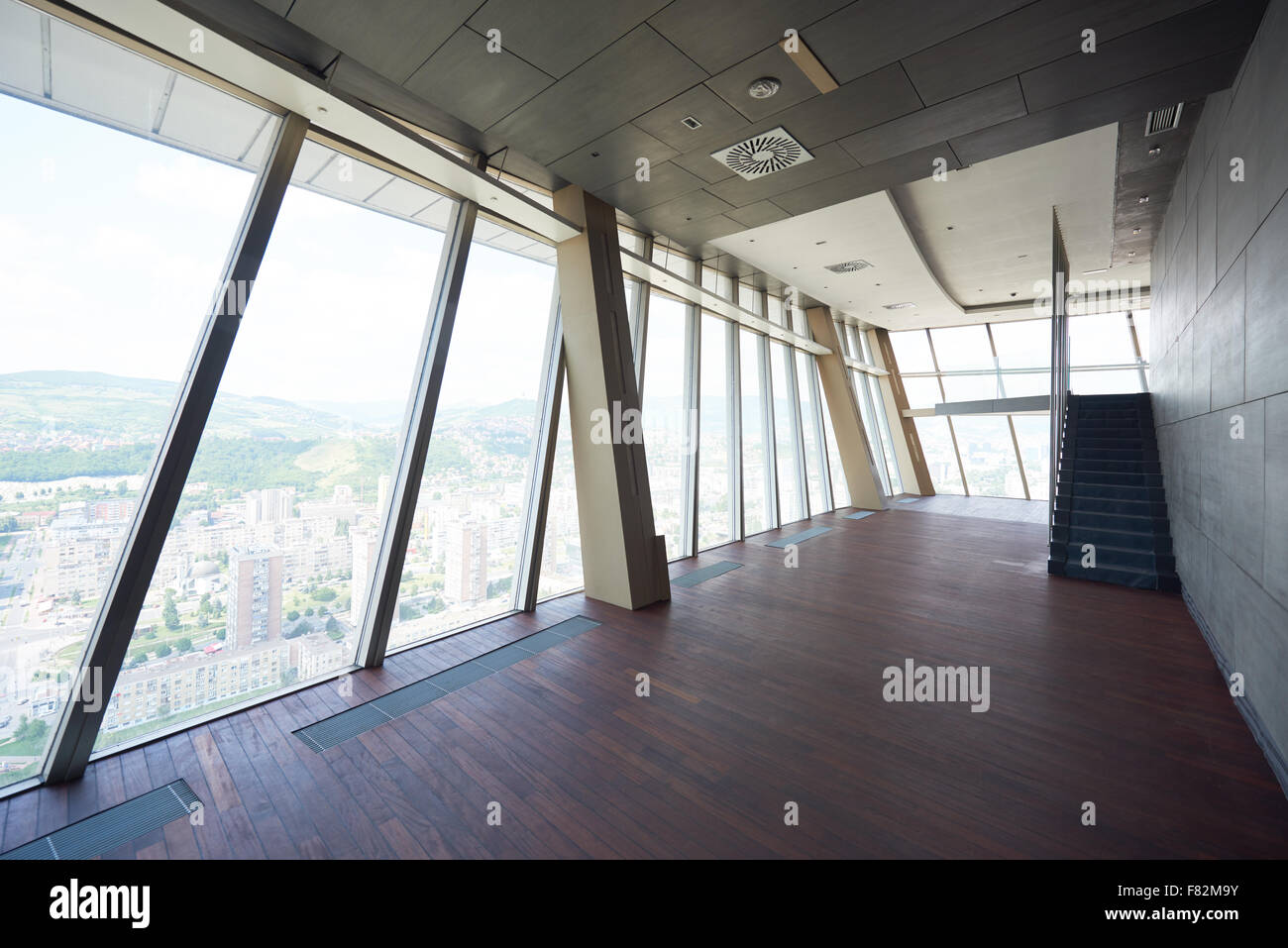 Big empty living room - Stock Photo Modern Bright Empty Office Or Living Room Interior With Big Windows And Stairs