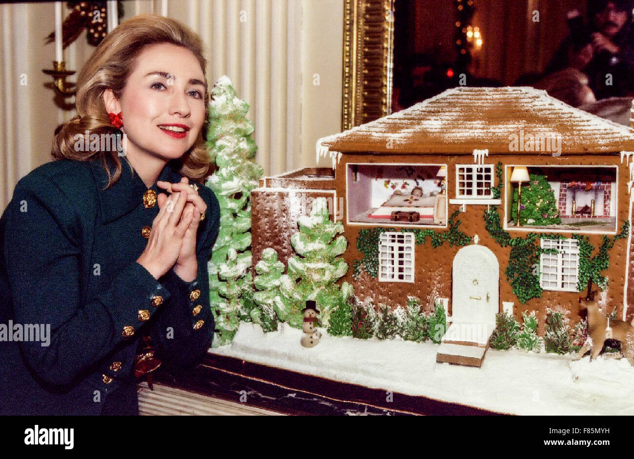 Former first lady Hillary Clinton in front of a gingerbread house ...