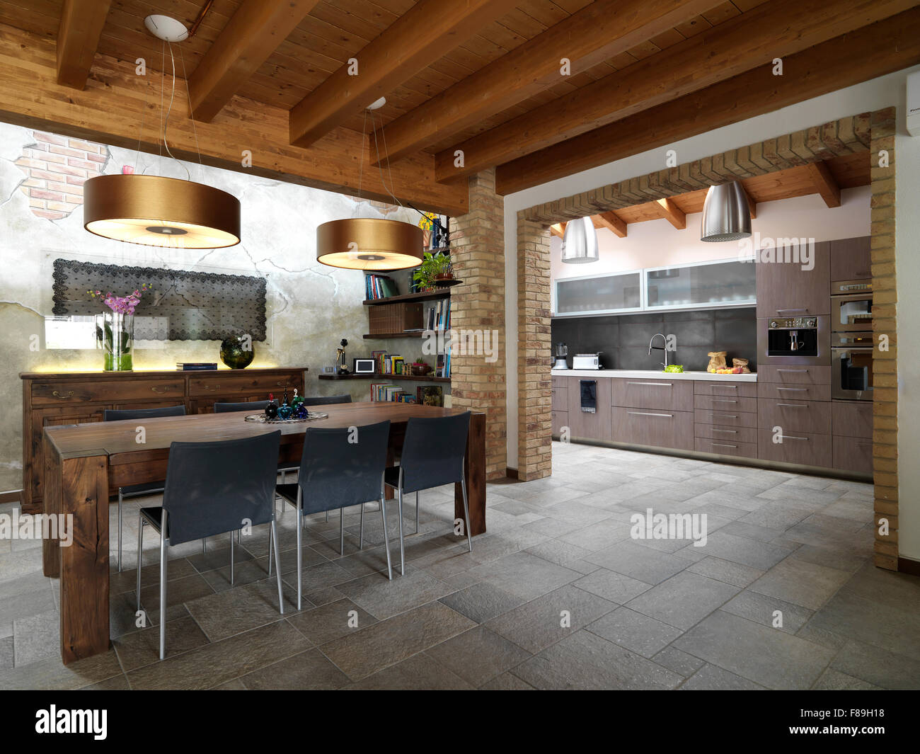 Foreground Of Dining Room In The Living Overlooking On Kitchen With Tile Floor And Wood Ceiling