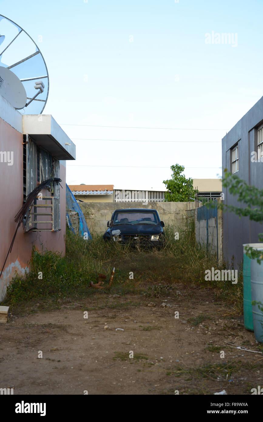 clunker car abandoned in a private home backyard juana diaz