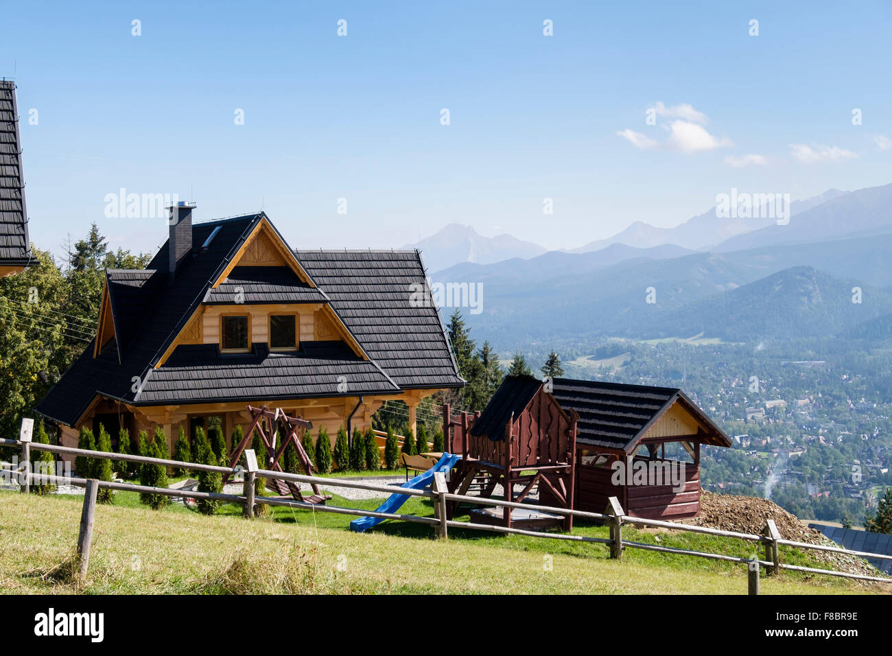 Traditional alpine wooden house overlooking high tatra mountains stock photo royalty free image - Traditional polish houses wood mastership ...