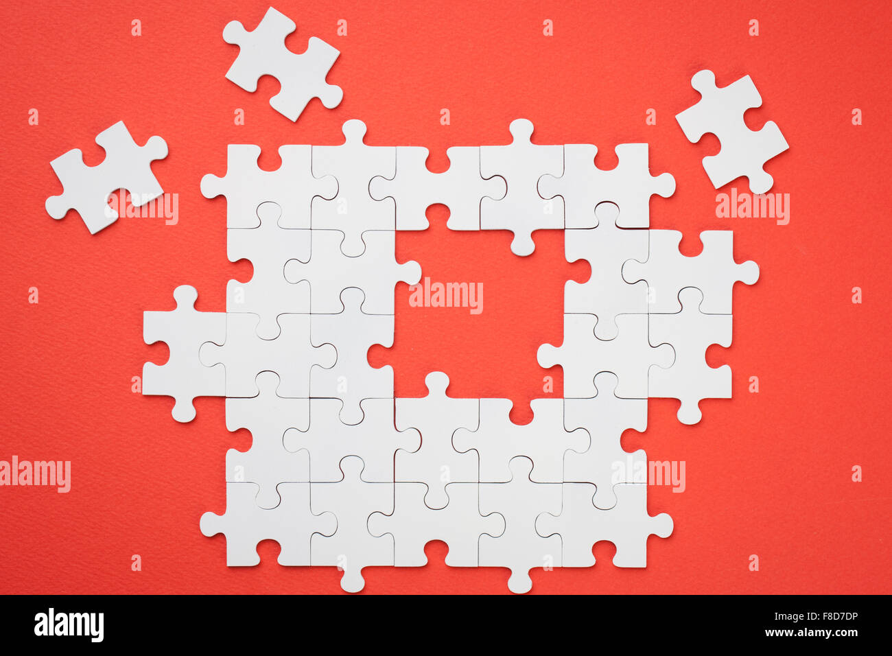 Frame made with white puzzle pieces with a few missing pieces on frame made with white puzzle pieces with a few missing pieces on red background jeuxipadfo Images