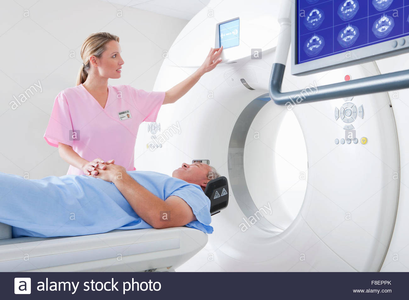 Technician Nurse Comforting Patient At Ct Scanner In Hospital ...