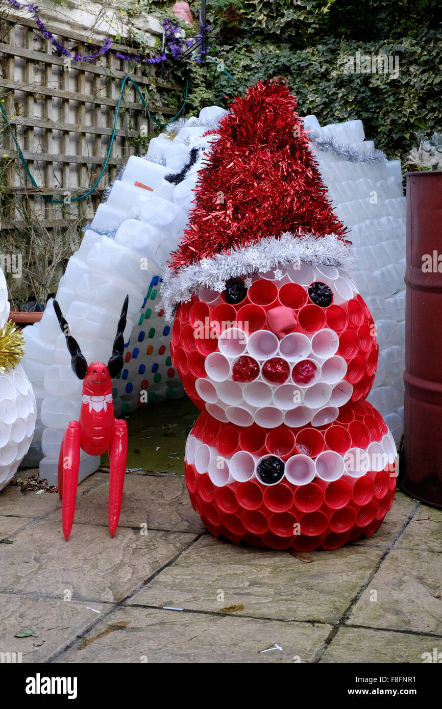 Stock Photo   Christmas Garden Igloo And Snowman Decorations Made From  Plastic Milk Cartons And Cups