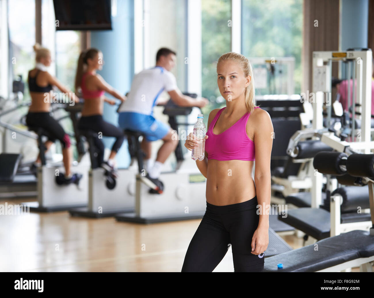 Young healthy blonde woman in fitness gym drink water stock photo stock photo young healthy blonde woman in fitness gym drink water sciox Gallery