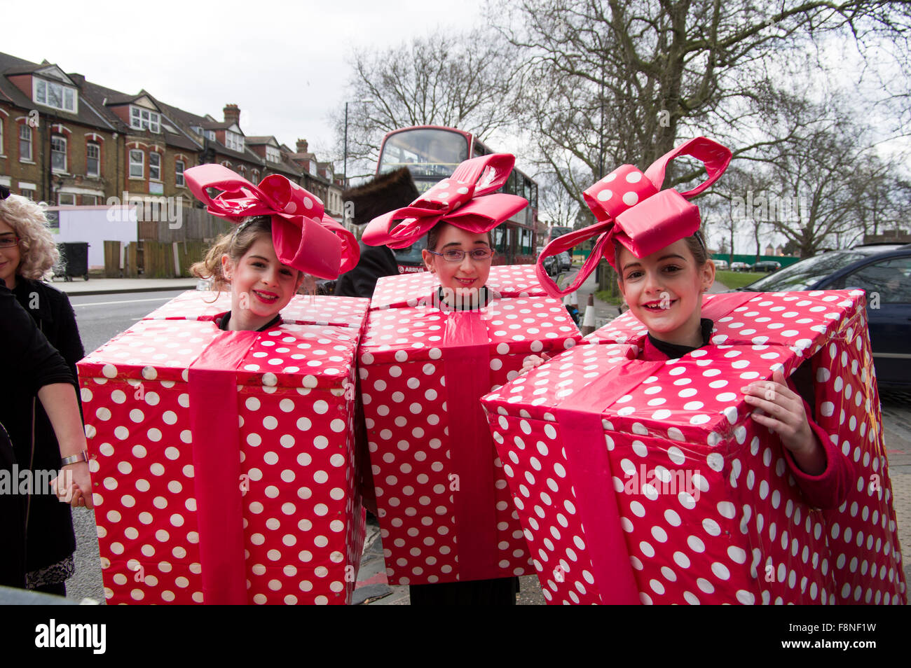 Three cheerful girls in homemade fancy dress costumes for ...