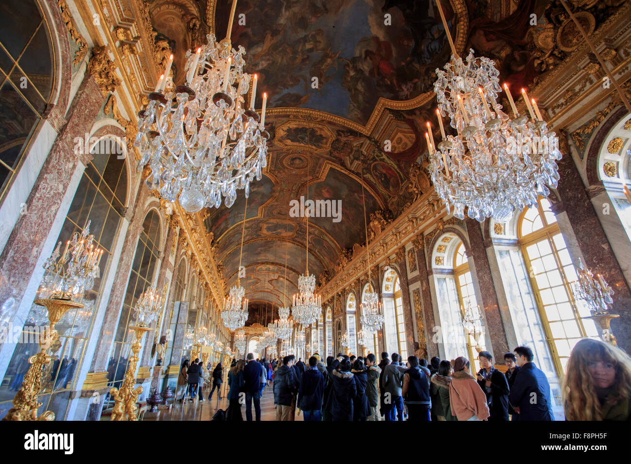 Opulent chandeliers line the roof of the hall of mirrors in the opulent chandeliers line the roof of the hall of mirrors in the palace of versailles paris france aloadofball Gallery