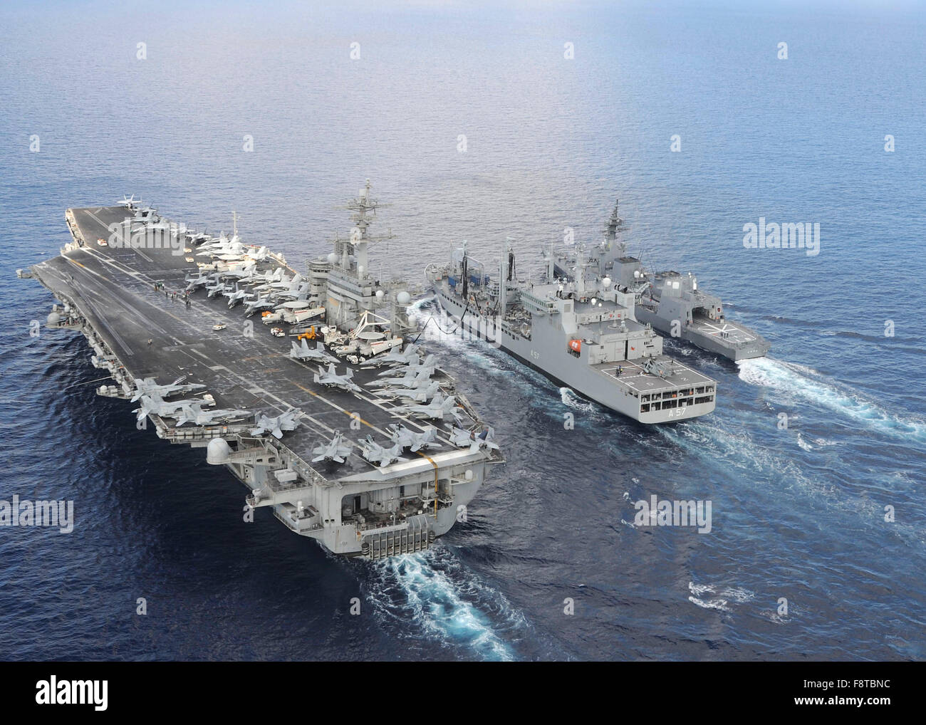 The aircraft carrier USS Theodore Roosevelt (CVN 71) and ...