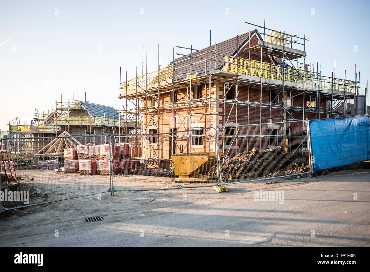 Building site with new homes under construction stock for Home construction websites