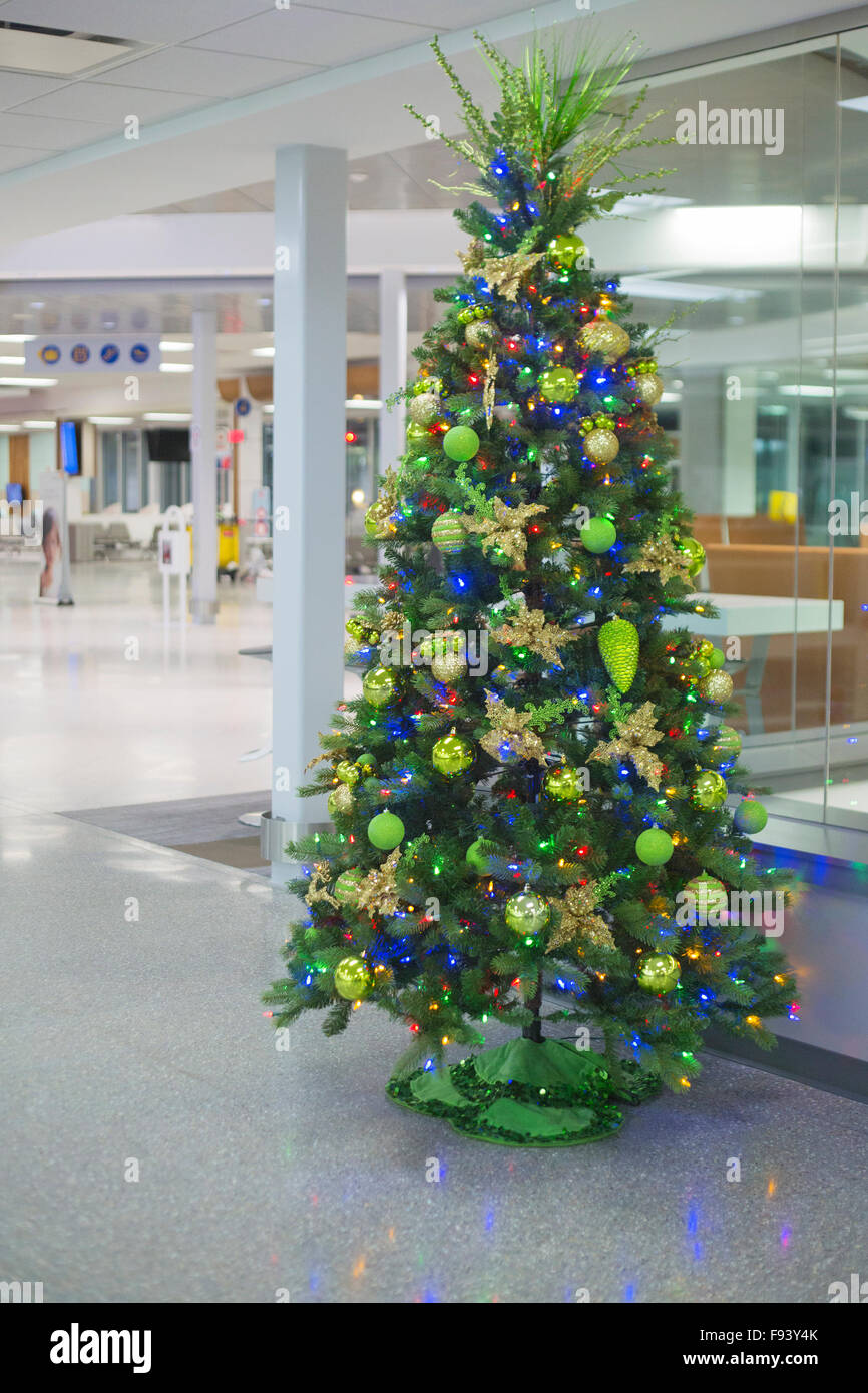 Christmas tree in empty airport stock photo royalty free