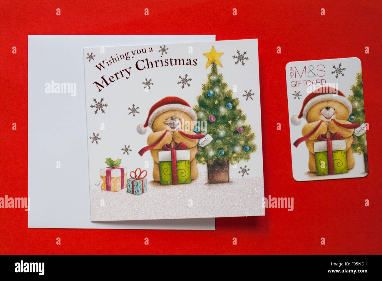 Ms christmas giftcard with wishing you a merry christmas card ms christmas giftcard with wishing you a merry christmas card gift card isolated on red background kristyandbryce Image collections