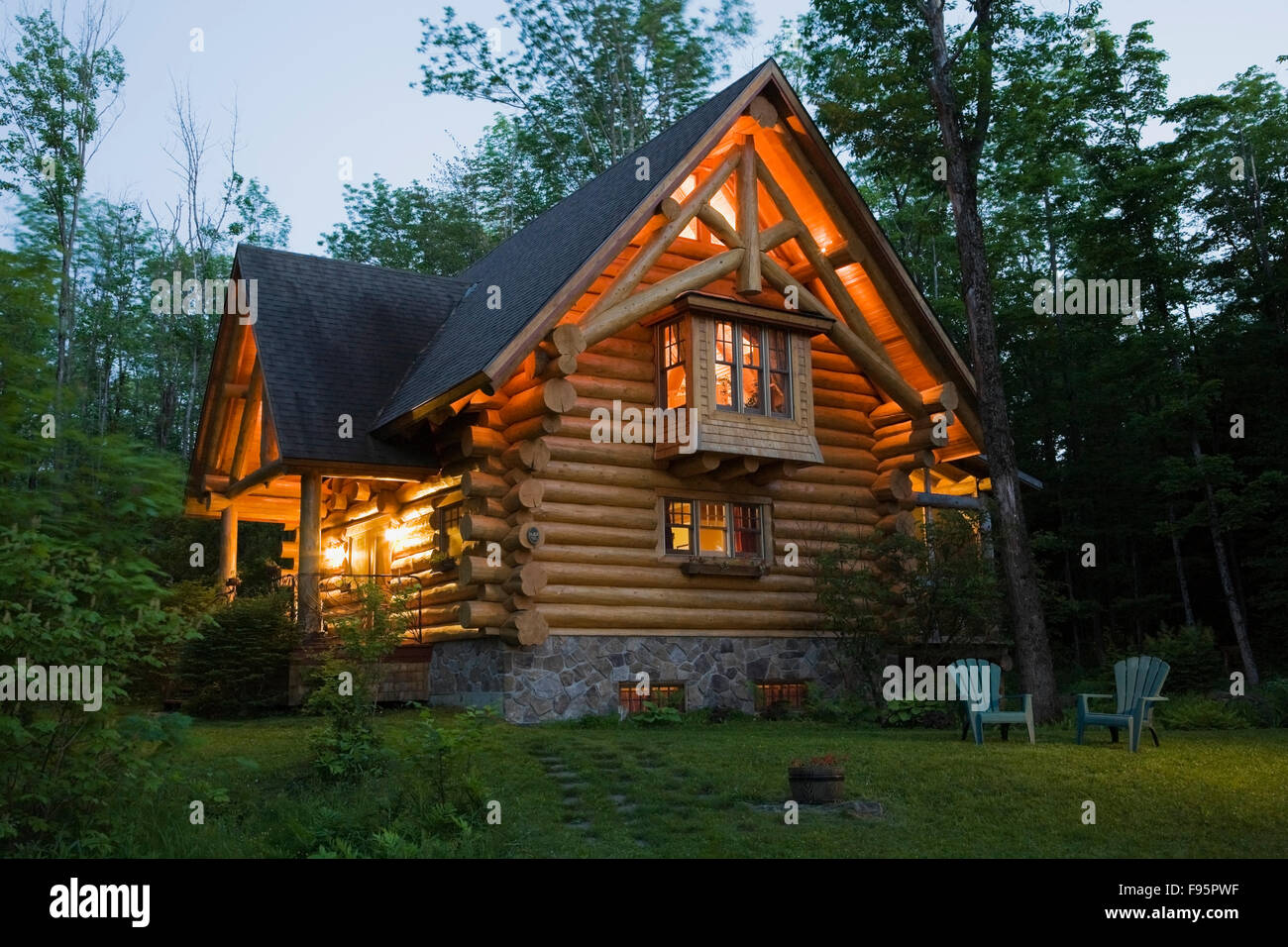 2003 built cottage style residential log home with a brown asphalt 2003 built cottage style residential log home with a brown asphalt shingles rooftop and a stone