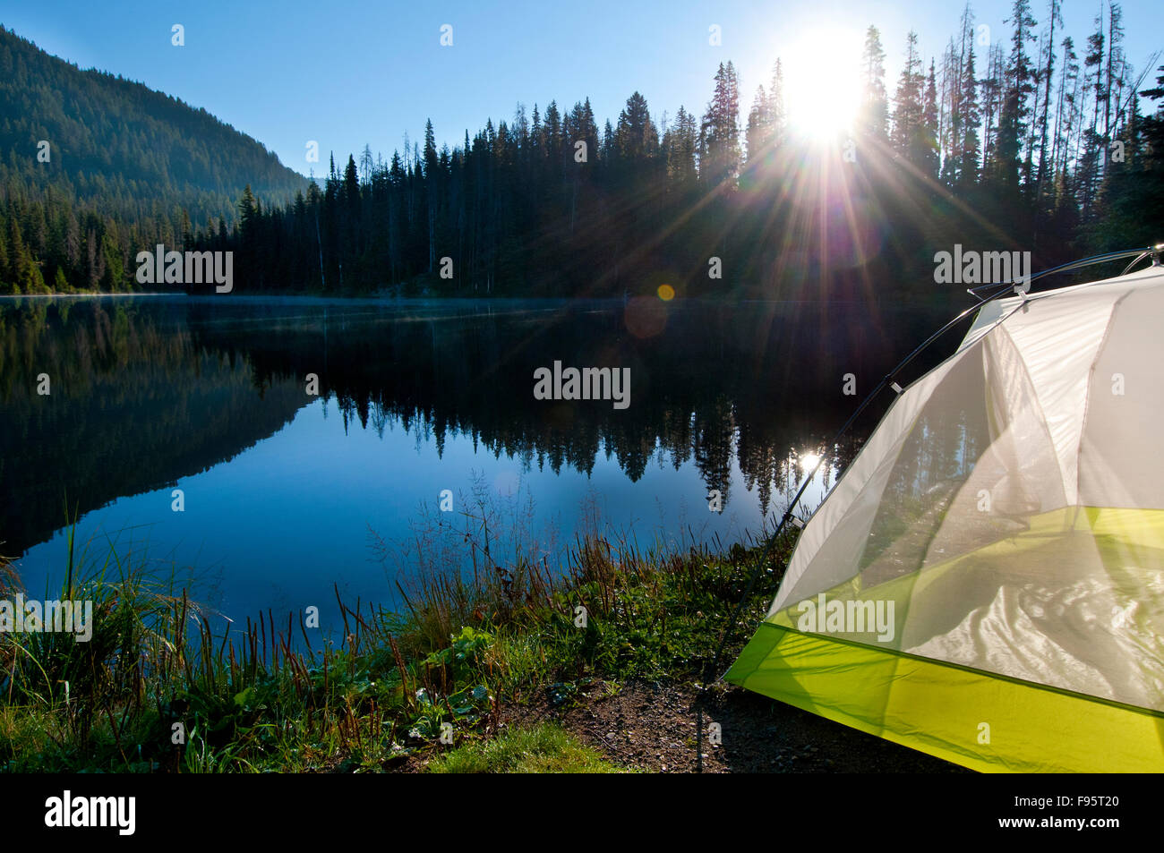 A tent is set up by Lightning Lake in Manning Park BC Canada & A tent is set up by Lightning Lake in Manning Park BC Canada ...