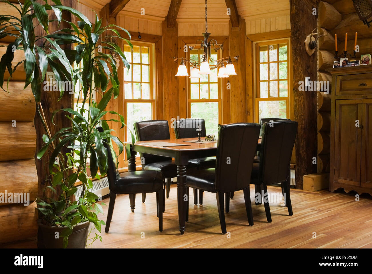 Wooden Dining Table With Leather Chairs In The Room Inside A 2003 Built Cottage Style Residential Log Home Quebec