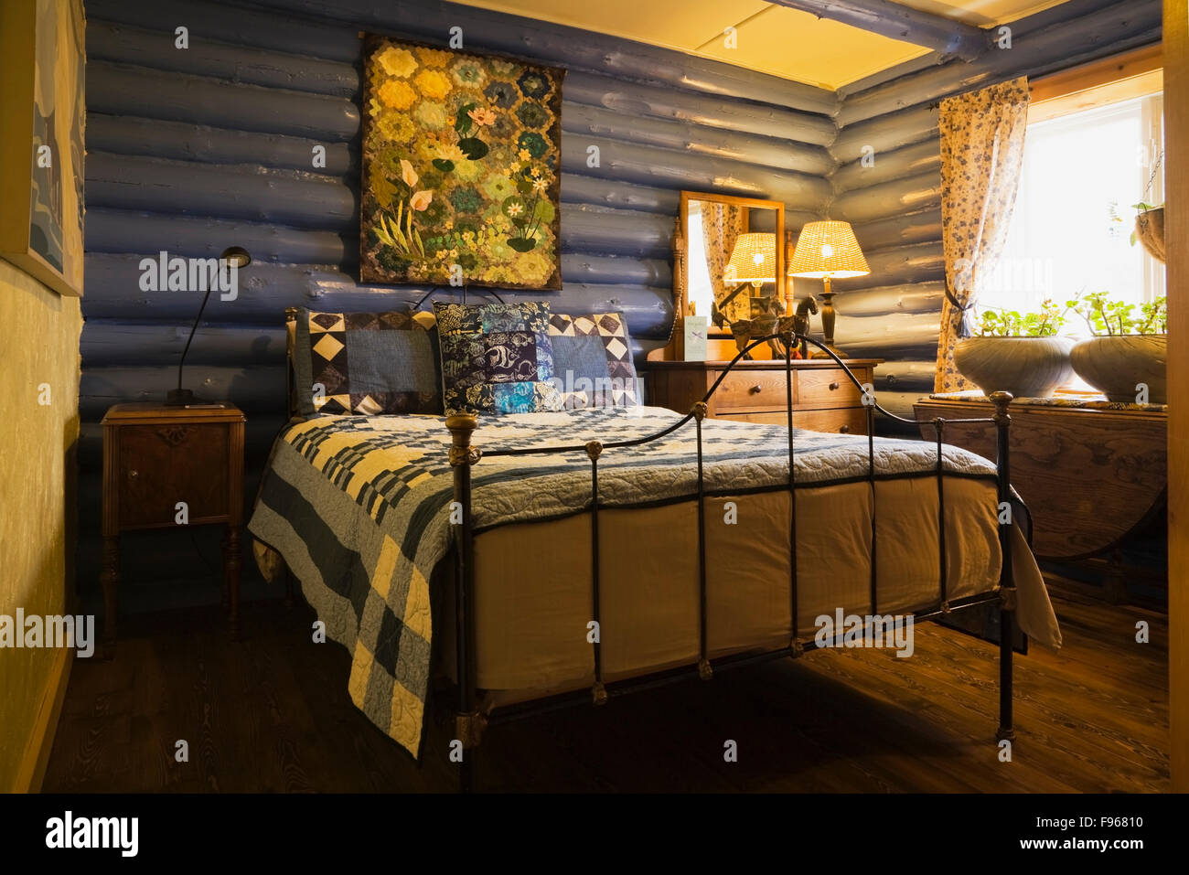 Country Cottage Bedrooms Model Property guest bedroom inside a country cottage style residential log home