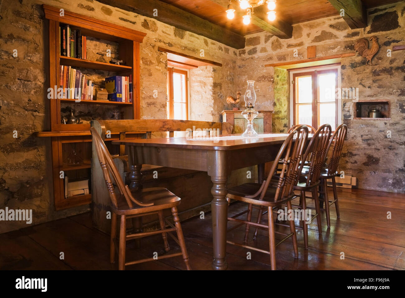 Antique Wooden Dining Table And Chairs In The Dining Room Inside An Old  Circa 1850 Cottage Style Fieldstone Home, Quebec, Canada