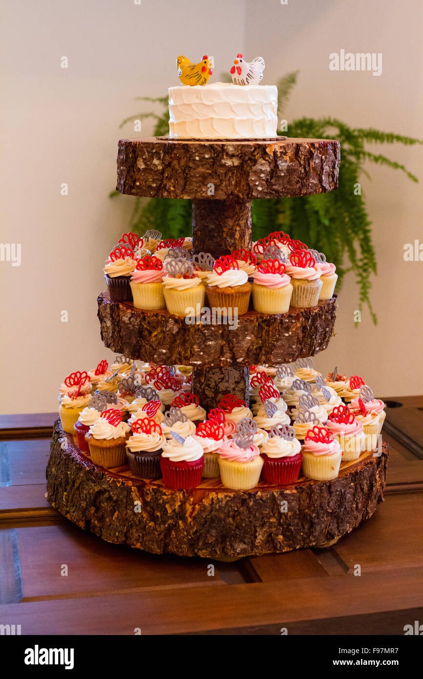 Wood Tower Holding Wedding Reception Cupcakes And A Cake For The Bride Groom