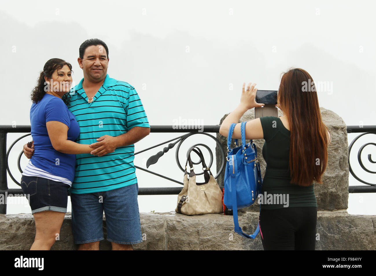 Stock photo tourists viewing the canadian falls and taking a selfie horseshoe falls view from niagara falls ontario canada