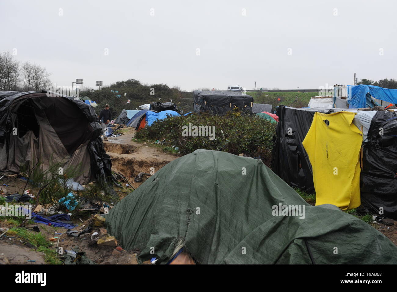 General view of tents and temporary shelters inside the demolition zone. Many tents are covered in tarpaulins to make them more weather tight. The day grey ... & Jungle Calais France. General view of tents and temporary ...