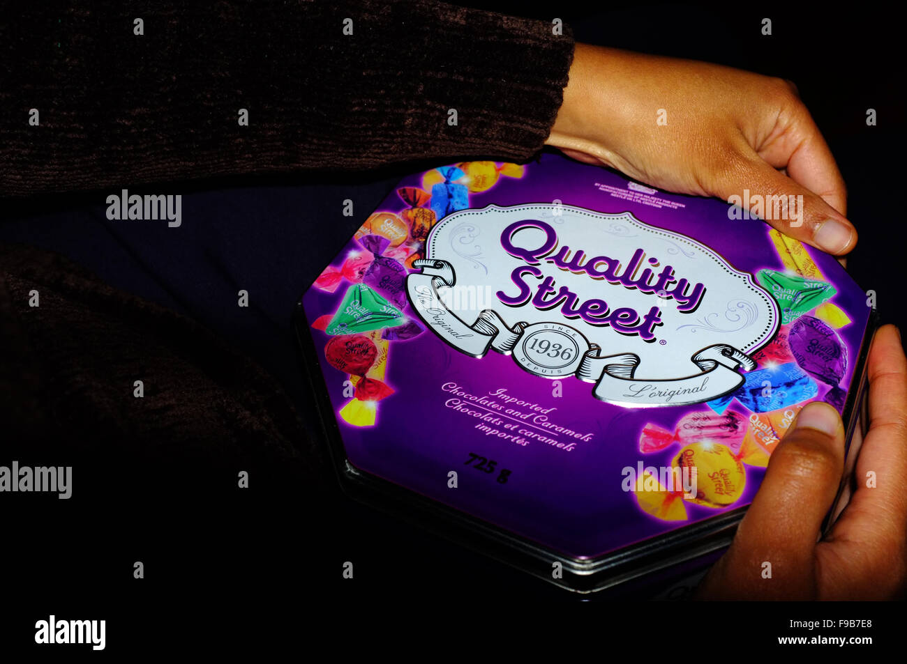 Black hands opening a Quality Street chocolate box Stock Photo ...