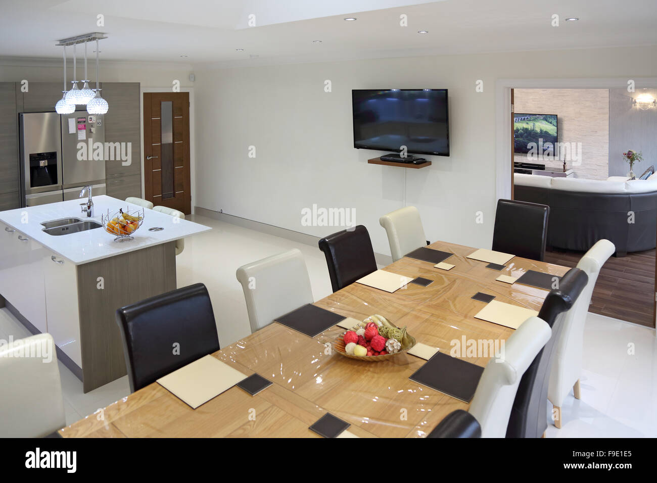 Kitchen dining room in a newly refurbished house showing living