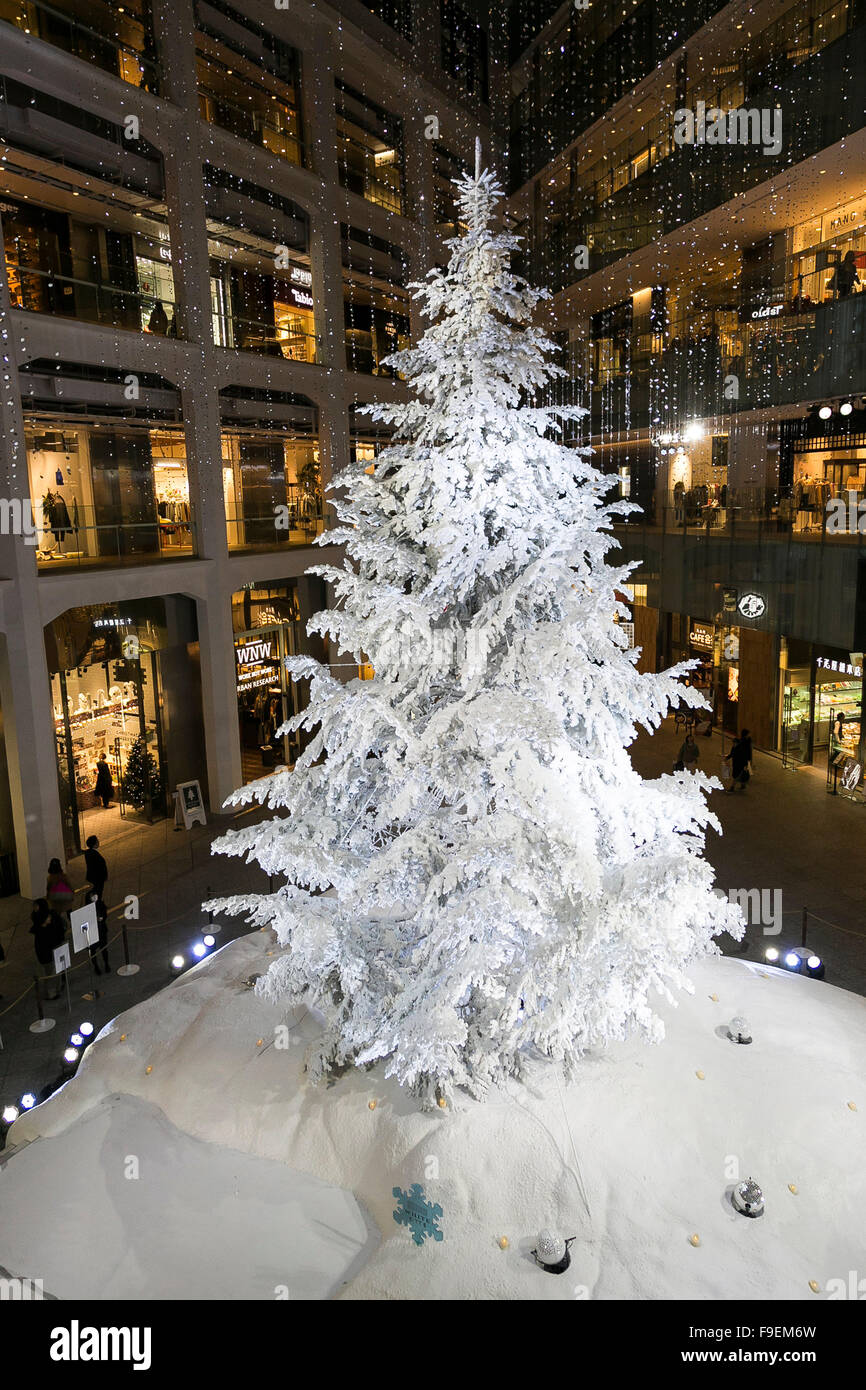 Visitors look at a 14.5m height snow covered Christmas Tree on ...
