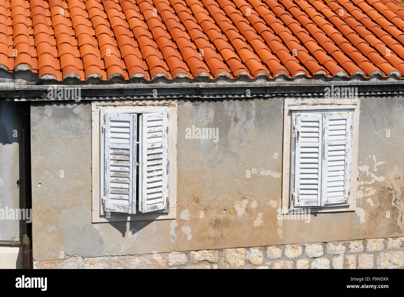An exterior of a house with wooden shutters in Dubrovnik, Croatia ...