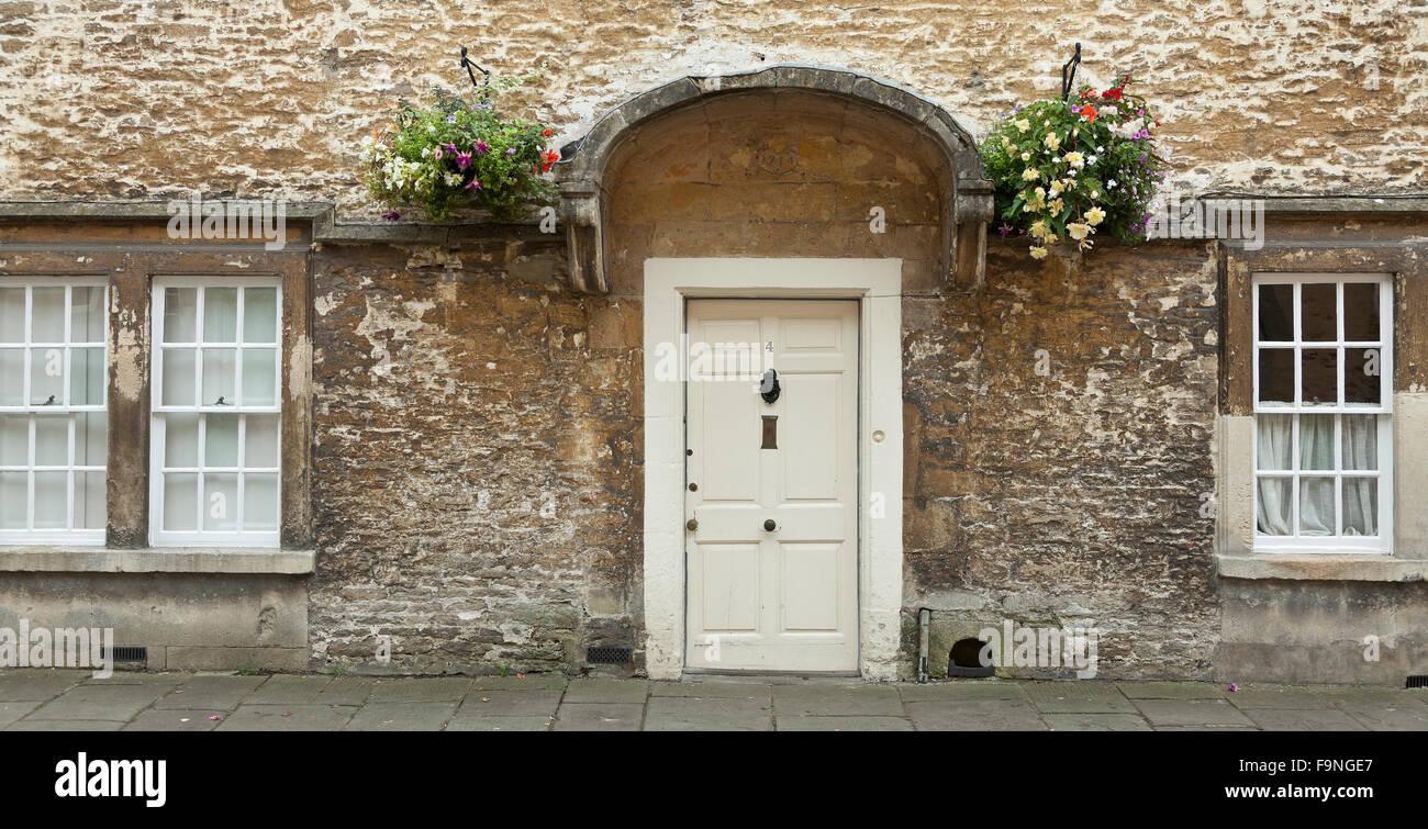 Flemish weavers cottage Cotswolds stone architecture Corsham Wiltshire buff grey stonework white door & Flemish weavers cottage Cotswolds stone architecture Corsham ... pezcame.com
