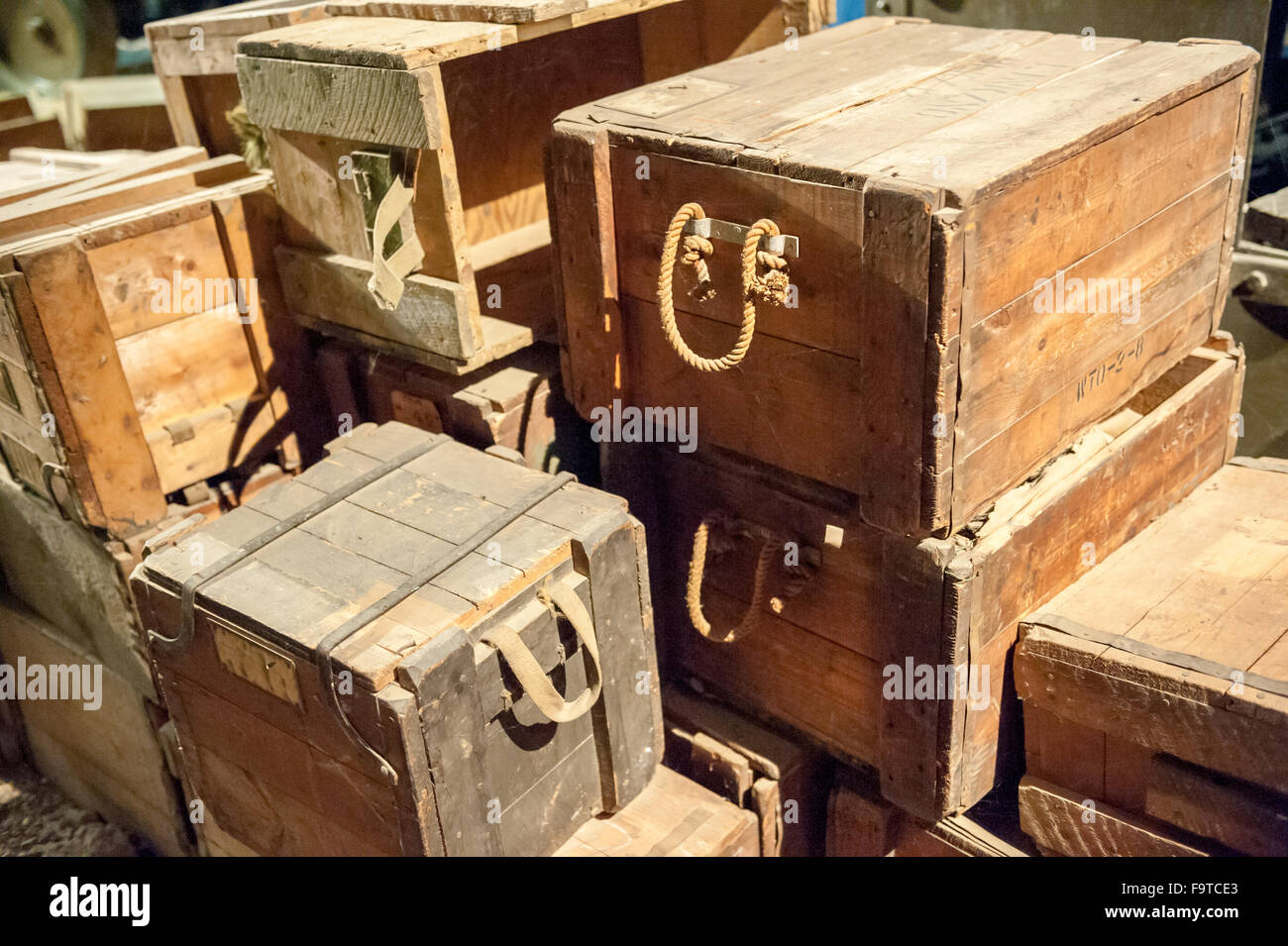 Stack of vintage wooden boxes with rope handles stock