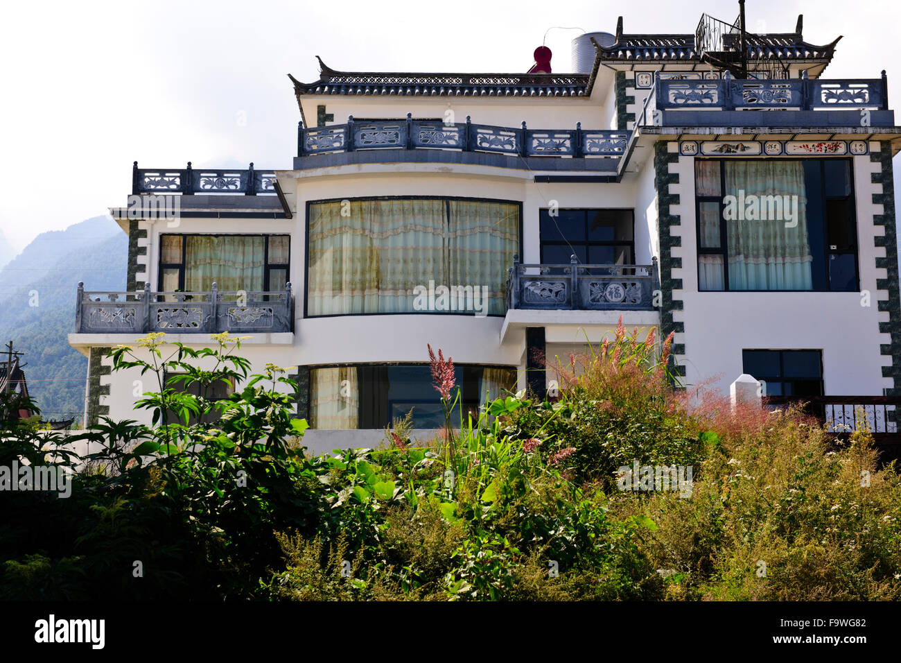 Stock photo traditional bai ethnic peoples modern stone houses built in traditional white wallssloping tiled roofsdaliyunnanchina