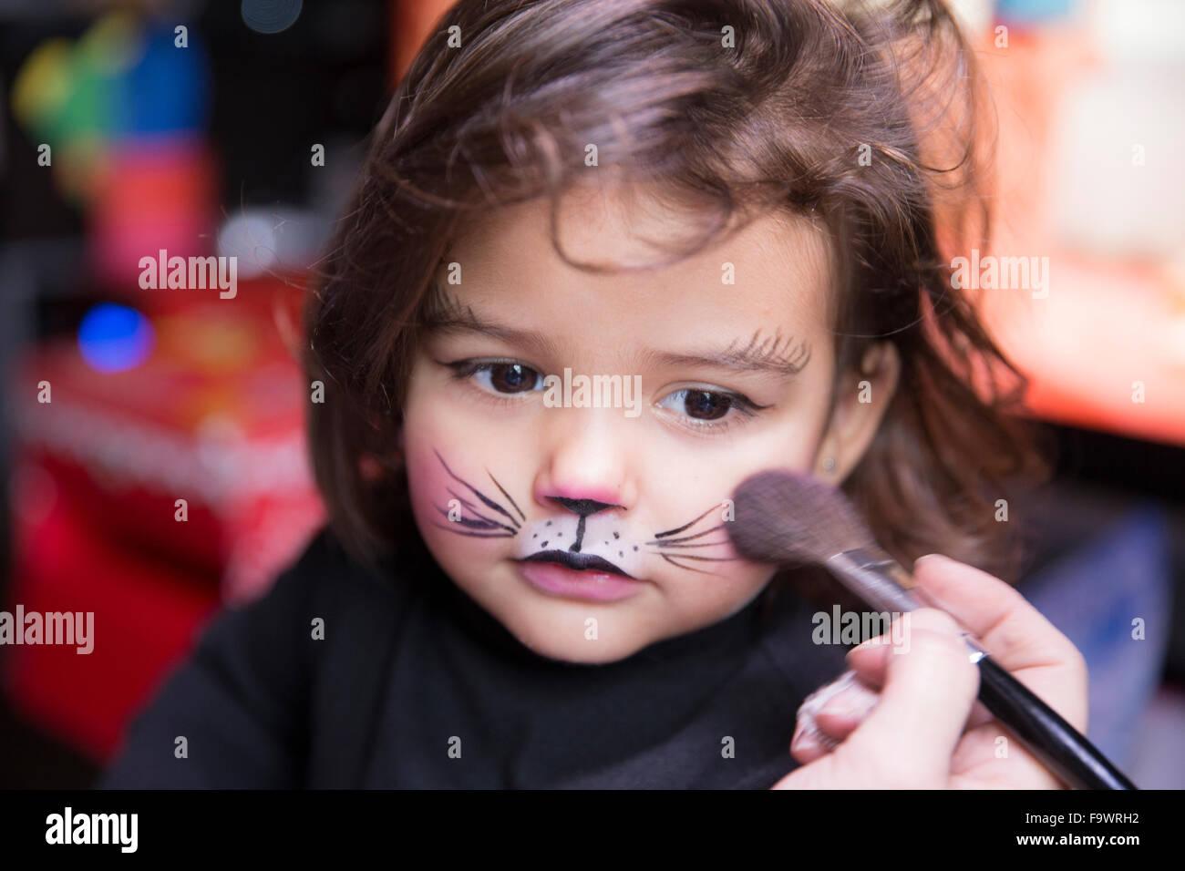 Uncategorized Cat Paint Face woman painting little girls face like a cat stock photo royalty cat